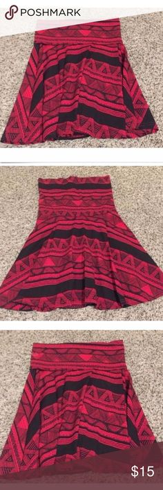 American Apparel Tribal Print Skirt - Red & black tribal print skirt from American Apparel. - Size small, but runs small I would compare it to an XS because American Apparel tends to run a little smaller. - 95% Cotton, 5% Elastan -Great condition, never worn!   **Top of skirt can be worn as high-waist or folded down- very versatile piece American Apparel Skirts A-Line or Full