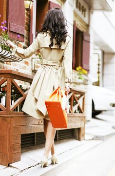 the bow, short heels, and the bright orange bag