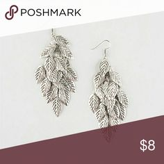 Full Tilt Leaf Chandelier earrings Features etched cascading etched leafs. Fish hook back. Imported. Full Tilt Jewelry Earrings