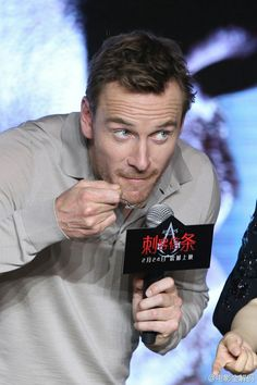 "Michael Fassbender tasting Chinese food on stage at the ""Assassin's Creed"" screening on February 20, 2017 in Beijing, China. #MichaelFassbender #Fassy #Fassbender"