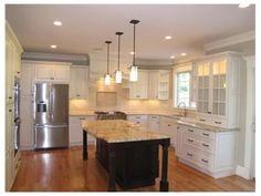 white kitchen, dark island