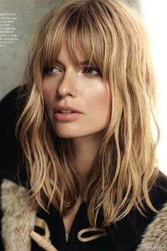 Spritz a sea salt texturizing spray into your hands and comb through your bangs for a beachy effect.  Read more: http://www.dailymakeover.com/trends/hair/ways-to-style-bangs/#ixzz3KrN272eM