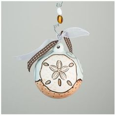 Glory Haus Sand Dollar Ornament | underthecarolinamoon.com #GloryHaus #GH #SandDollar #ChristmasOrnament #BeachOrnament #UTCM #UnderTheCarolinaMoon