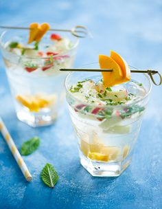 Tropical Sangria Recipe  2 oz. White Wine (Sauvignon blanc, pinot grigio, or other crisp white)   1 oz. White Rum   1/2 oz. fresh Lime Juice   1/2 teaspoon Sugar   1 Tablespoon diced Apples   1 Tablespoon diced Mango   2 lrg Mint leaves, chopped   2 oz. Club Soda