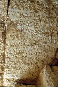 Palmyra.   Re-used inscription built into the wall of the staircase within the headquarters building of the Camp of Diocletian. The inscription is on its side and has been re-oriented accordingly. Procillianus was governor of Phoenicia in AD 207.