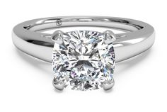 This 14k white gold solitaire engagement ring secures and elevates your center diamond with a cathedral setting, showcasing it and all of its sparkling beauty. This is a fairly thin band, so it will emphasize your diamond even more. This ring can be set with any size or shape diamond.