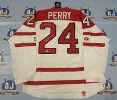 COREY PERRY Team Canada SIGNED 2010 Olympic JERSEY w/ 2010 Gold Note . $493.05. This is an official licensed SIGNED Corey Perry Olympic Team Canada jersey. The jersey is brand new with all of the lettering and numbering professionally sewn on. The player has beautifully signed the number. To protect your investment, a Certificate Of Authenticity and tamper evident hologram from A.J. Sports World is included with your purchase.