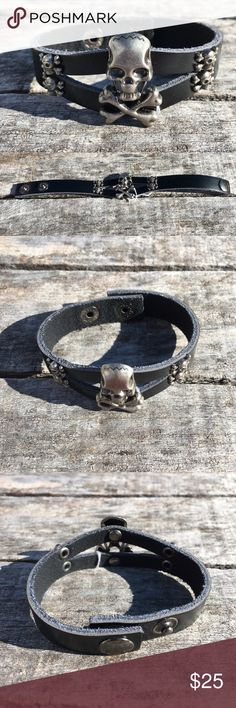 List! Black Skull/Crossbones Leather Cuff! NEW! One large center skull and 4 smaller skulls. Two snap closure. Measures 8.5 inches long. These were listed as real leather. NWOT - has been on display but no sign of damage. Boutique Accessories Jewelry