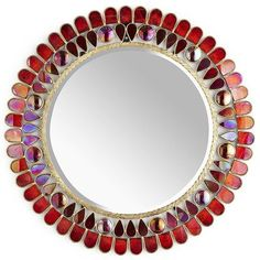 Alluring Mirror...it's real enchantment lies in the scalloped glass border and red gem detail that glistens like rubies.