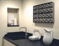 Tone on Tone: Our Basement Renovation - love the old bundt pan hung as art!