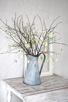 Lots of adaptations possible.choose limbs from your backyard, display in an old pitcher, sap bucket.you can also spray paint limbs if your's aren't very pretty. Hoppy Easter, Easter Bunny, Easter Eggs, Easter Flowers, Easter Tree, Egg Tree, Holiday Fun, Holiday Decor, Sweet 15