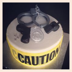Police themed cake--take crime scene tape and wrap around with toy handcuffs and badge