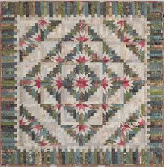 Judy Martin designs the most beautiful log cabin quilts.