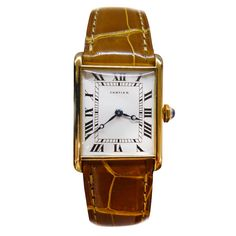 Yellow Gold Tank Louis Cartier Wristwatch.   From a unique collection of vintage wrist watches at http://www.1stdibs.com/jewelry/watches/wrist-watches/