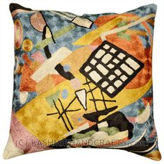 KANDINSKY BLACK FRAME DECORATIVE PILLOW COVER Star fragments and enigmatic hieroglyphs artfully stitched in the finest Kashmir wool chainstitch needlework. Cosmic colors like blue, lavender and silver complement earthier tones of terra cotta, harvest green and amber to recreate a design based on the work of influential Russian artist, Wassily Kandinsky.The exciting pattern evokes the thought of a ladder to the stars, a comet's tail,or a star map.