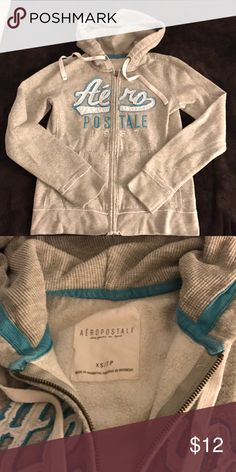 Aeropostale Hoodie Zipper Sweatshirt Aeropostale Hoodie Zipper Sweatshirt. Cozy thermal lined hood. Gray with white and turquoise accents. Aeropostale Tops Sweatshirts & Hoodies