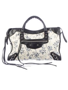 Get on the floral trend now with this Balenciaga Toile Floral City Bag.