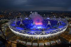 Opening Ceremony  Smoke rises from the Olympic rings as they are suspended over the stadium during the Opening Ceremony at the 2012 Summer Olympics, Friday, July 27, 2012, in London.