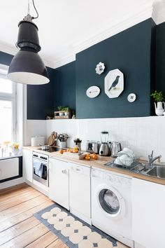 "I would love to add white subway tile to my kitchen for a back splash with ""dirty"" robin's egg blue walls and dark cabinets...I wish I owned my home."