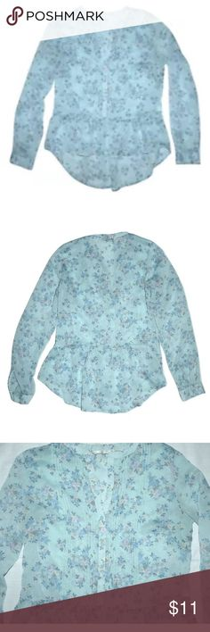 """Laura Conrad Sheer See Through Hi Lo Peplum Top Laura Conrad Sheer See Through Hi Lo Peplum Top  It is in very gently used, overall very good clean condition.  •4 buttons at the top area, does not button all the way down, the bottom peplum does not have any buttons •Completley sheer see through •Blue floral print •Long sleeves, with a single button at the cuff •Pintuck detail on either side of the front buttons •Bust: 34 inches around •Length: 22"""" down the front & 26"""" down the…"""