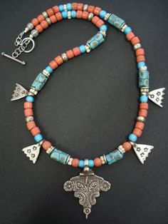 by Luda Hunter | Six antique rareVenetian beads traded in Africa, old Naga coral glass beads found in Thailand, antique blue whiteheart african beads, antique Czech bohemianflower beads, old Mauritanian silver spacer beads, four solid silver small hamsa pendants and a beautiful silver focal pendant from Essaouria, Morocco. | 345$