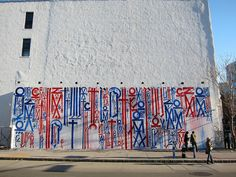 RETNA gearing up to finish his Houston / Bowery mural, via Flickr.