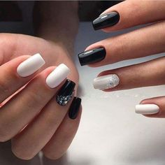 Simply beautiful black and white nail art design with stones