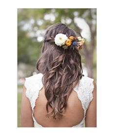 Loose Curls  A cascading waterfall braid adorned with fresh flowers looks effortless, but is polished and elegant.