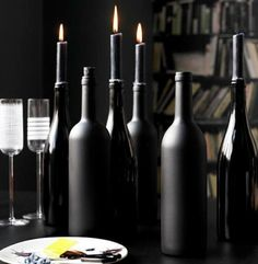 Spray Paint used wine bottles matte black to use as candle holders   an Architect Abroad / Halloween Roundup