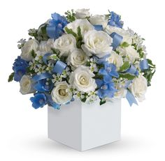 C35 Celebrating Baby Boy. Celebrate the coolest baby boy's arrival with this charming box arrangement that arrives chock full of pretty flowers. Perfect for baby showers too!