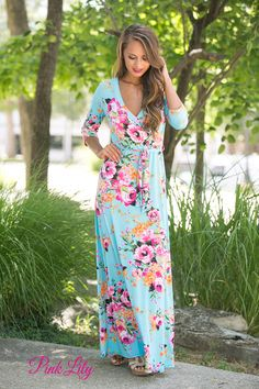 You will love wearing this comfortable and gorgeous floral maxi all summer long! Featuring floral print in shades of pink, green, orange, black, and white paired with a aqua fabric, it has the best colors of spring and summer rolled into one dress!