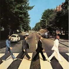 Abbey Road - The Beatles - The front cover design, a photograph of the group traversing a zebra crossing, was based on sketched ideas by McCartney, and taken on  August 8th, 1969 outside EMI Studios on Abbey Road. At around 11:30 that morning, photographer Iain Macmillan was given only ten minutes to take the photo whilst he stood on a step-ladder and a policeman held up the traffic.