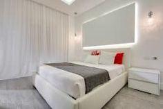 Dormitorios de estilo moderno de SERENA ROMANO' ARCHITETTO