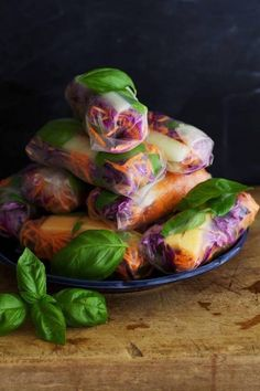 Paleo Summer Rolls (makes about 15 rolls) about 15 paleo coconut paper wrappers spicy cilantro almond pesto 1/2 purple cabbage - thinly sliced 1/4 - 1/2 ripe honeydew melon 3 medium carrots - shredded 2 cups fresh basil leaves large handful fresh mint leaves 45-60 steamed shrimp peeled Perfect for the beach cooler! #scottsonnon #paleo fast-and-fit.tumblr.com