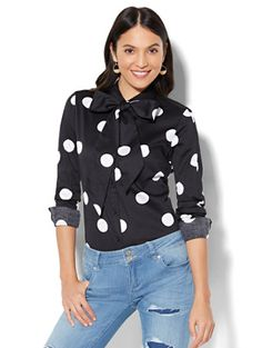 A self-tie bow detail adds a tailored accent to our iconic Madison Stretch Shirt - we love the bold polka-dot print in graphic black and white! Exclusively at New York and Company.