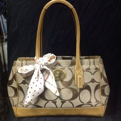 """Authentic Coach brown monogram tote w/scarf. Authentic Coach monogram medium sized tote. Large front pocket w/turn lock closure. Large back pocket. Inside zippered security pocket. Zipper along the top of handbag to close tote. Media pockets. Measures approx. 15"""" X 8"""". Side snaps for expansion. Strap drop approx. 8"""". Coach Bags Totes"""