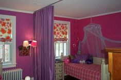 Divide a bedroom using a ceiling mount curtain track and curtains.