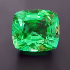 Kornerupine, a rare mineral occasionally used as a gemstone. It appears frequently in parcels from Ceylon and Tanzania and may be confused with beryl, peridot, topaz, or quartz.  Most Kornerupine is brownish and although beautiful stones come along once in a while, they are never that large and green. This stone is very well cut and the color is outstanding.