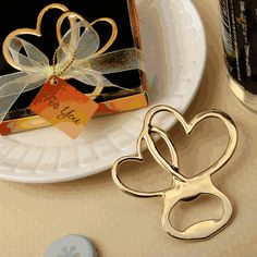 Metal Double Heart Bottle Opener with Gold Finish- Celebrate your shared eternal love with these beautiful entwined hearts! They are also functional bottle openers that guests will be thrilled to take home as a memento of your occasion. A special eve Wedding Favors Cheap, Bridal Shower Favors, Wedding Favours, Engagement Favors, Anniversary Favors, Summer Bridal Showers, Heart Party, Online Gift Shop, Bottle Openers