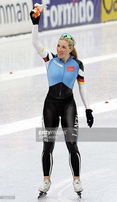 German skater Anni Friesinger waves after winning the women's 5000m race of the Single Distances Speed Skating World Championships 06 March 2005 in Inzell. Compatriot Claudia Pechstein is second, Canadian Clara Hughes placed third.