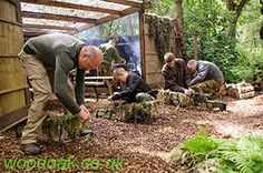 Preparing Equipment at Base Camp on a Sniper Experience at Woodoak Wilderness, Surrey, England UK www.woodoak.co.uk