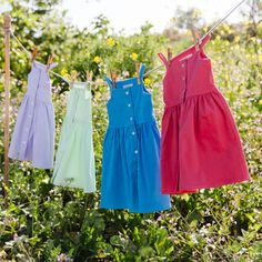 $46 | Pips and Poppy 'Heather Dress' in Lavender, Sweet Mint, Blueberry and Rosy Red. Button-up sundress made with 95% soft cotton and 5% spandex. Timeless Classics made for play! #littlegirlsdress #girlsclothes Little Girl Summer Dresses, Little Girls, Red Button, Summer Looks, Poppy, Blueberry, Lavender, Mint, Spandex