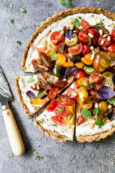 Tomato Ricotta Tart Recipe: Buttery crust filled with ricotta mixture and topped off with juicy heirloom tomatoes.