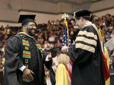 From JSO  Photo Gallery:  UWM graduates Kitonga Alexander receive his Masters Degree at U.S. Cellular Arena