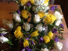 Yellow, white and purple flowers at The Bell