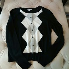 Black argyle cardigan *NWOT* New york and company black cardigan white grey and white diamonds down the front. size SMALL. Black buttons. Long sleeve. Brand new-- never worn. Back is solid black. Super soft material. Retailed for 45. Willing to accept offers and trades. I ship fast! New York & Company Sweaters Cardigans