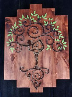 Tree of Life string art on wood planks. Amazingly intricate.