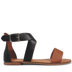 Crafted from a modern cimbination of supple black and brandy leather, these simple sandals are the perfect addition to summer dressing. With a delicate cross over strap and polished silver buckle, pair Cody with a floaty maxi dress or denim shorts for ult