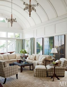 Paintings by Stephen Pentak preside over the family room, which features chandeliers from Objets Plus, sofa pillows clad in a Schumacher linen, and a rug by Tai Ping. Design by Mariette Himes Gomez Living Room On A Budget, Small Living Rooms, Living Room Designs, Living Spaces, Modern Living, Architectural Digest, Long Island, Barrel Vault Ceiling, Colonial Mansion