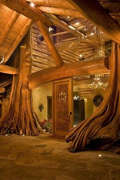 This cool entryway basically makes me think of a giant treehouse (via Log Home Living / log cabin)
